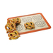The SILPAT® Perfect Pretzel Mat makes perfectly uniform and perfectly spaced pretzels. Use the pretzel outlines as a guide when forming your dough. The non-stick mat allows the pretzels to slide off the pan and makes clean-up easy after decorating with chocolate or adding cheese.