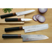 Damascus steel and hammer pattern make a beautiful blade and the combination of two types of wood used for the handle enhances the feel of a Japanese knife. A total of seven different shapes of knives are available in this series.